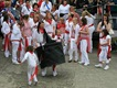A childrens oss dancing on the harbour ramp